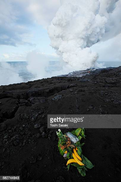 offering for goddess pele at lava ocean entry - pele goddess stock pictures, royalty-free photos & images