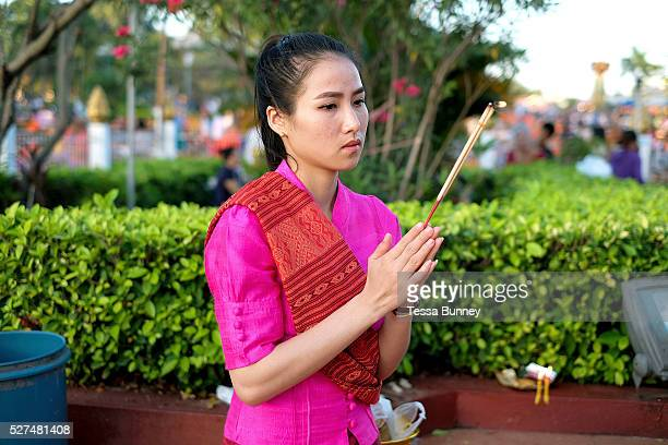 Offering incense at the That Luang festival Vientiane Lao PDR Vientiane's most important Theravada Buddhist festival Boun That Luang is held for...