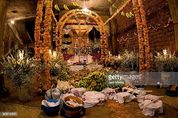 Offerings are displayed in an altar during celebrations of the Dia de los Muertos in the district of in San Angel Zurumucapio on November 1 2009 in...