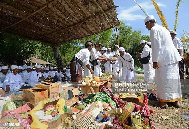 Offerings are left by Javanese Hindus as they take part in a Melasti ceremonial prayer on Pulau Merah in Banyuwangi regency in East Java province on...