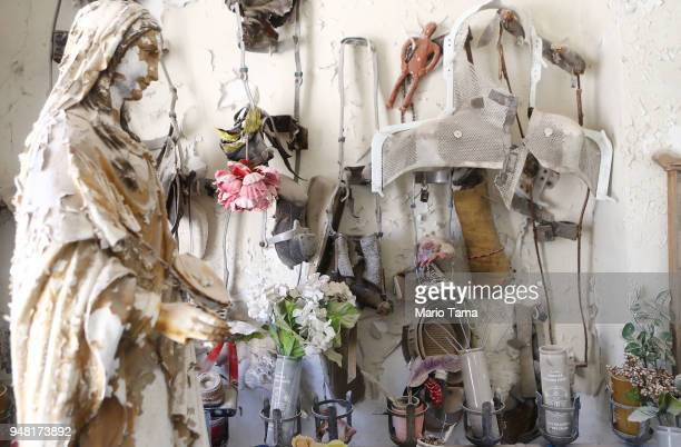 Offerings are viewed during renovations in St Roch Chapel dedicated in 1865 on April 16 2018 in New Orleans Louisiana Visitors historically leave...