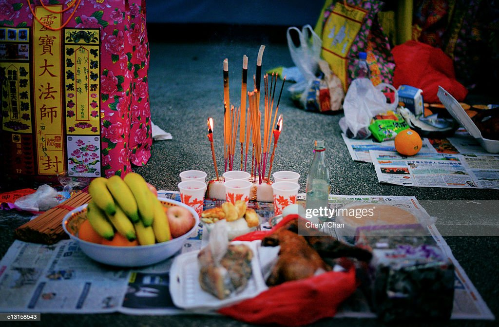 Offerings at the Chinese Hungry Ghosts Festival : Stock Photo