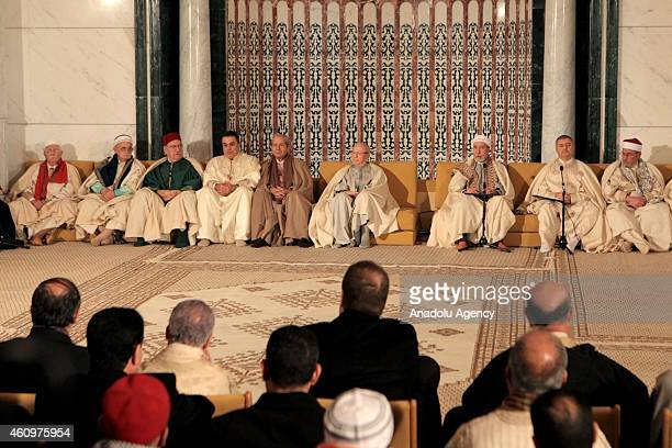 Officals are seen inside the Malik ibn Anas Mosque during the ceremony for the 1444th anniversary for the celebration of Mawlid alNabi a holy day for...