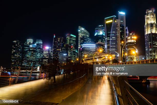Office and financial buildings, and Jubilee Bridge in Marina Bay in Singapore in the night