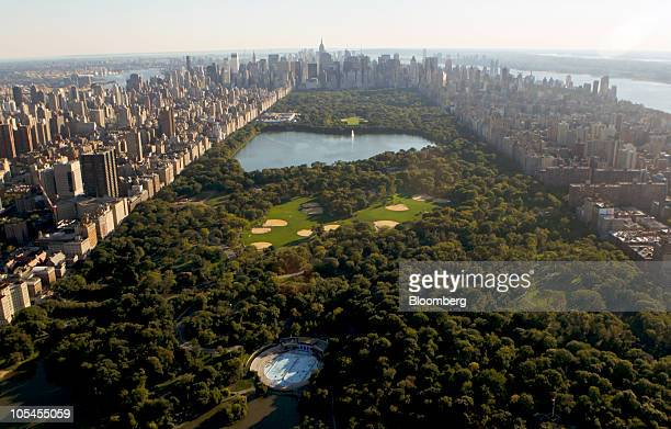 Office and residential buildings including the Empire State Building are seen surrounding Central Park in this aerial photograph taken over New York...