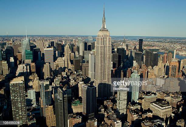 Office and residential buildings stand around the Empire State Building in midtown Manhattan in this aerial photograph taken over New York US on...