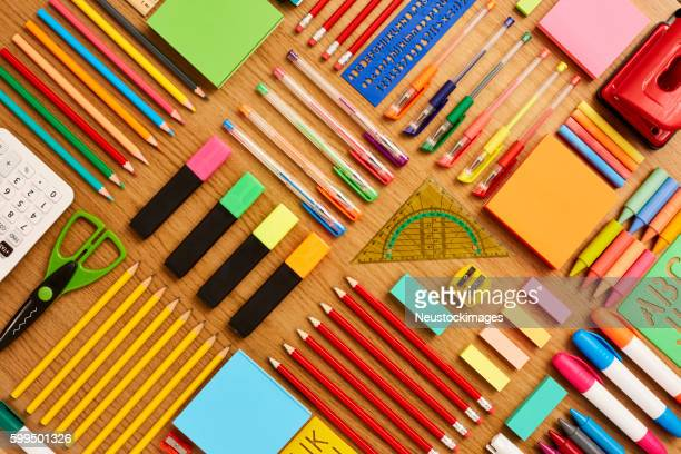 office and school supplies arranged on wooden table - knolling - group of objects stock photos and pictures