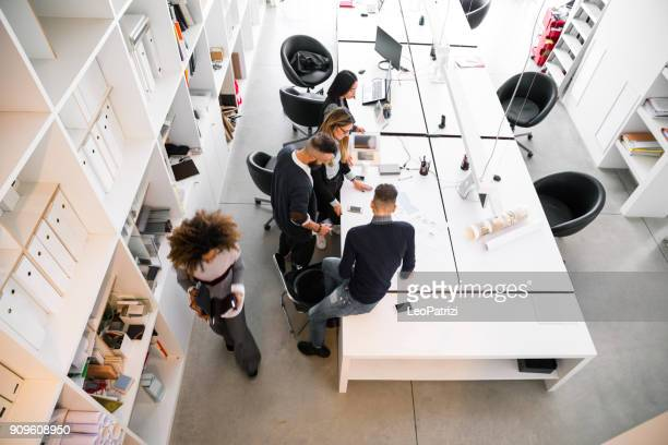 office architect team working on tasks - new and young business - design studio stock pictures, royalty-free photos & images