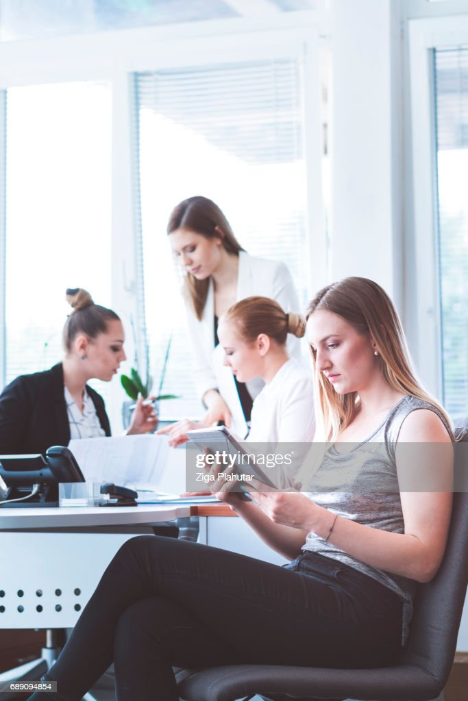 Office assistant analyzing latest financial results : Stock Photo