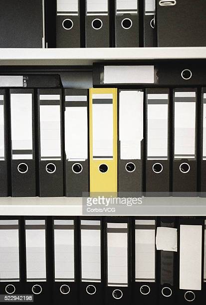 office binders on shelves - vcg stock pictures, royalty-free photos & images