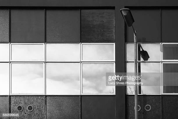office block windows reflecting clouds - lucy shires stock pictures, royalty-free photos & images