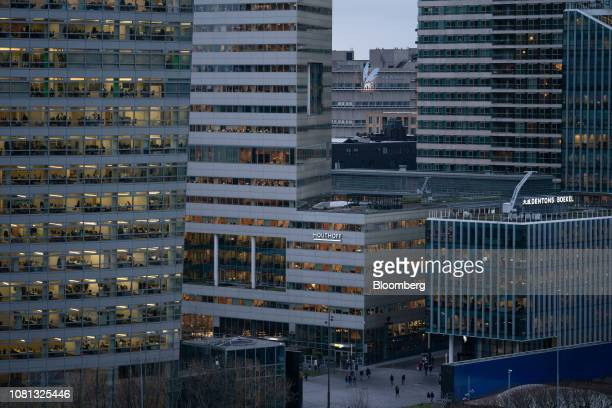 Office blocks stand illuminated at dusk in the Zuidas financial district in Amsterdam Netherlands on Friday Jan 11 2019 A large part of the latest...