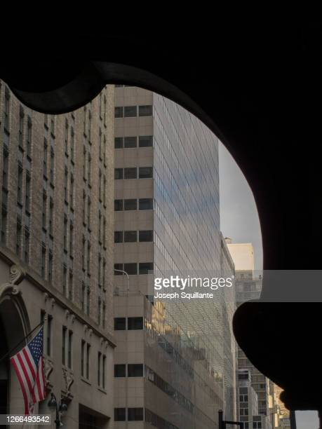 office building and grand central station detail with american flag - joseph squillante stock pictures, royalty-free photos & images