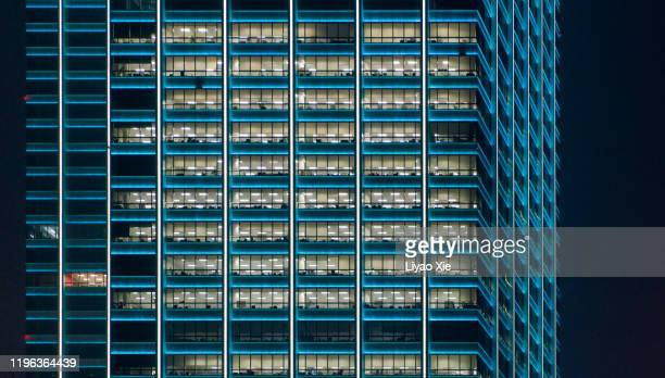 office building at night - liyao xie stock pictures, royalty-free photos & images