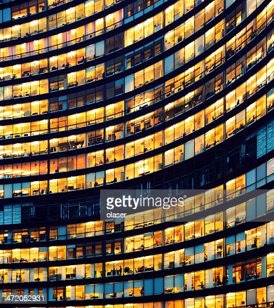 Office building at night with illuminated windows