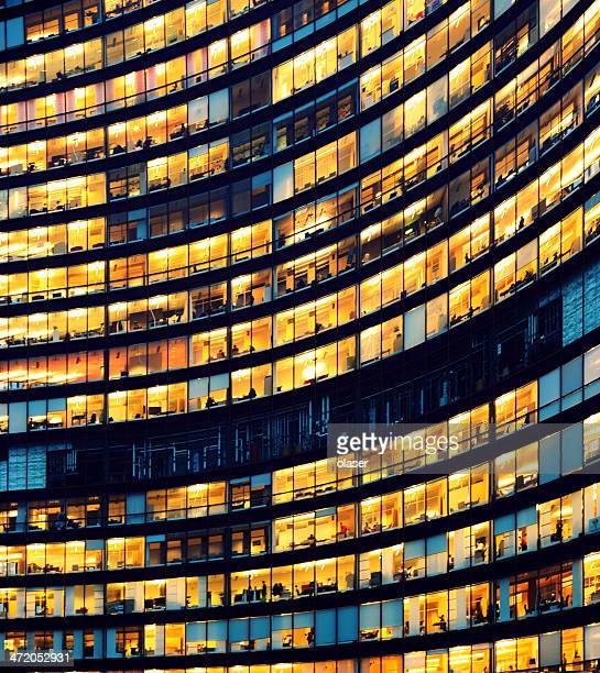 office building at night with illuminated windows - building exterior stock pictures, royalty-free photos & images