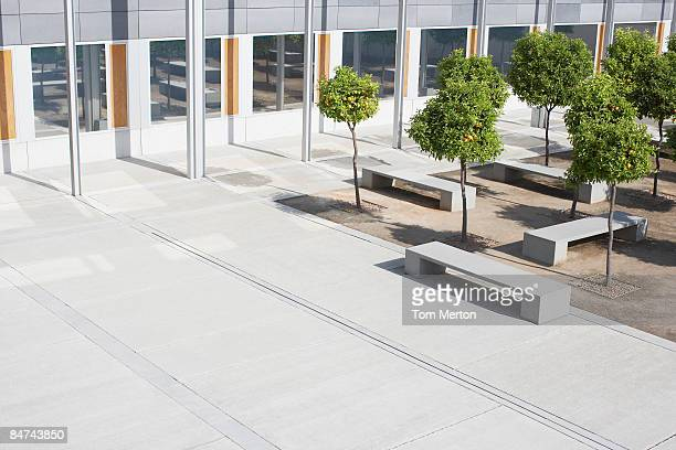office building courtyard - landscaped stock pictures, royalty-free photos & images
