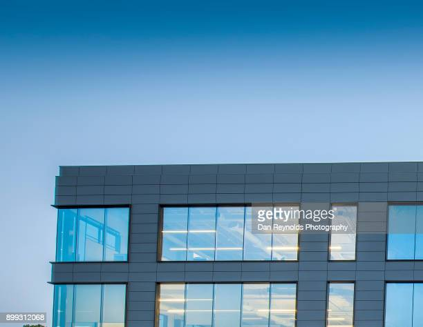 office building exterior against sky - facade stock pictures, royalty-free photos & images