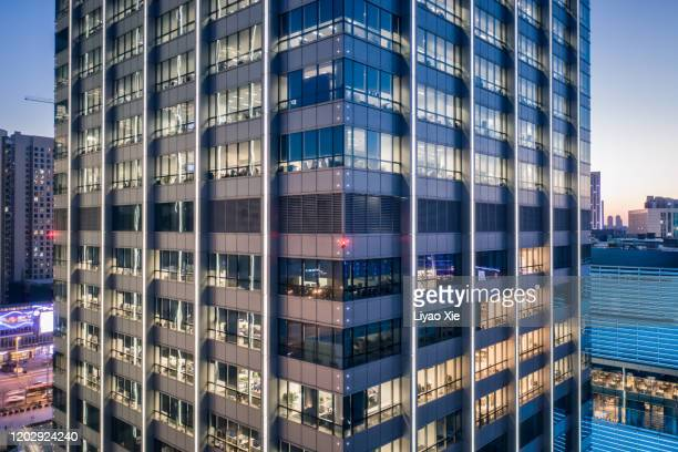office building facade at night - liyao xie stock pictures, royalty-free photos & images
