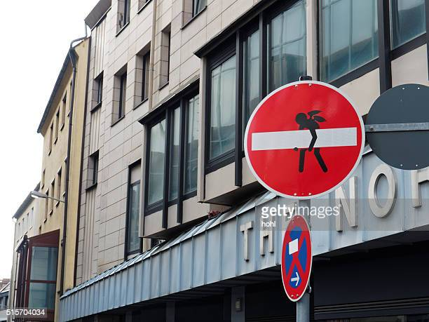 office building facade with one way street traffic sign