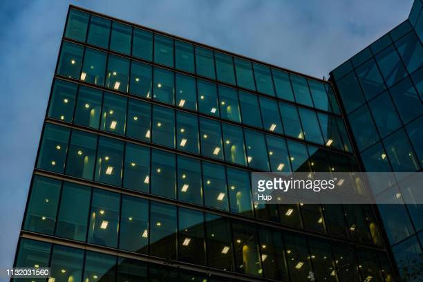 office building illuminated at night - office block exterior stock pictures, royalty-free photos & images