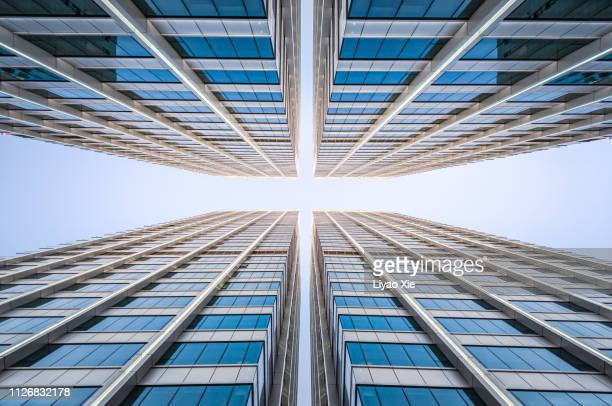 office building, low angel view - skyscraper stock pictures, royalty-free photos & images