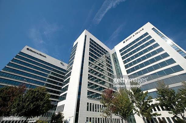 office building of ernst & young - ernst & young stock photos and pictures