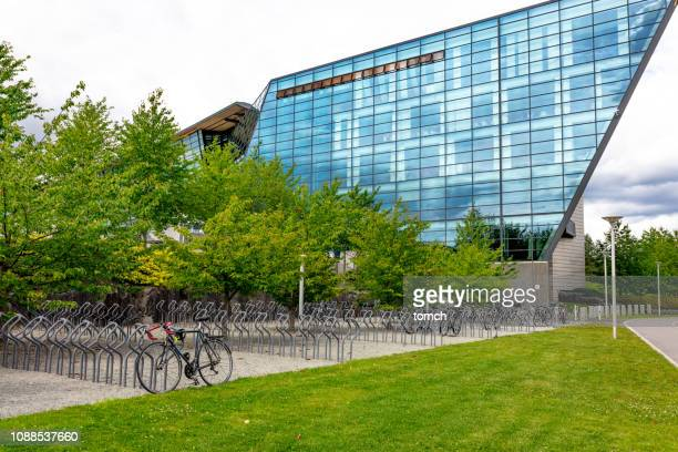 office building - bicycle parking station stock photos and pictures