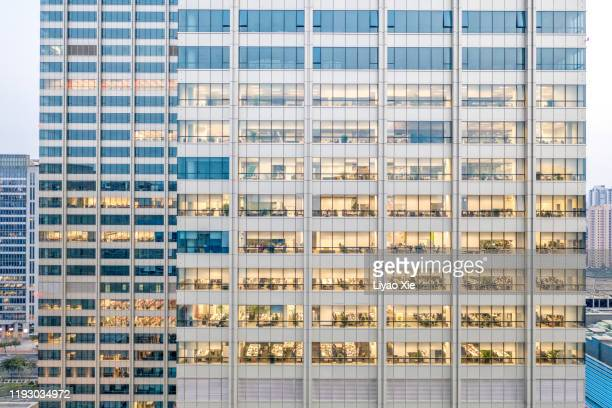 office building - 996 working hour system stock pictures, royalty-free photos & images