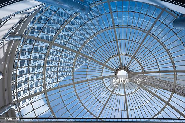 office building seen through glass roof - canary wharf stock photos and pictures