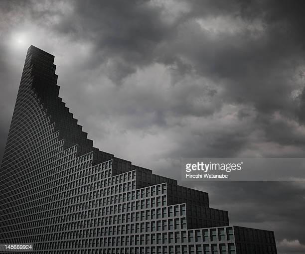 office building that shaped falling bar graph - rezession stock-fotos und bilder