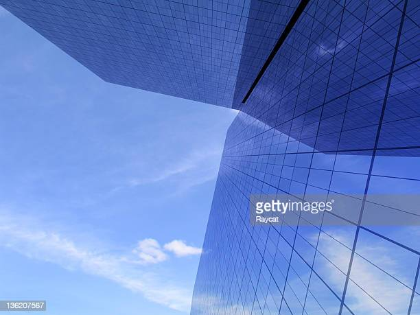Office buildings against bright sky