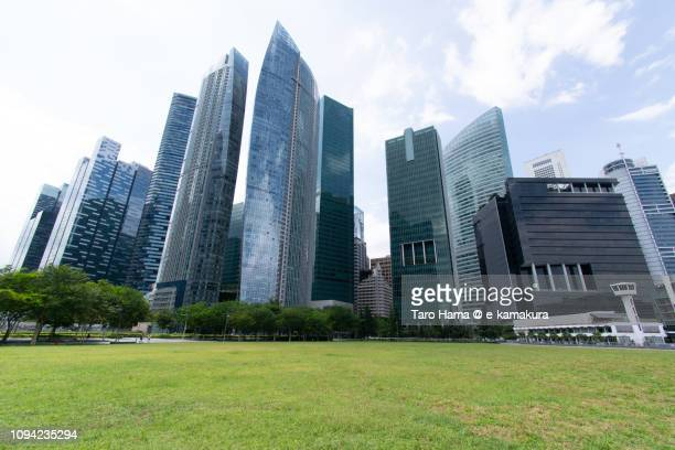 Office buildings and green grass in Marina Bay in Singapore
