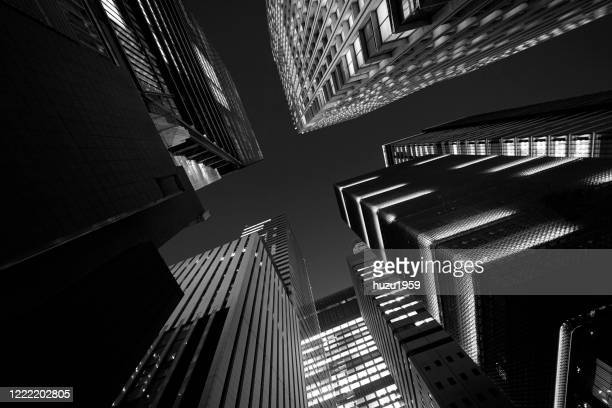 office buildings at night - recessed lighting stock pictures, royalty-free photos & images