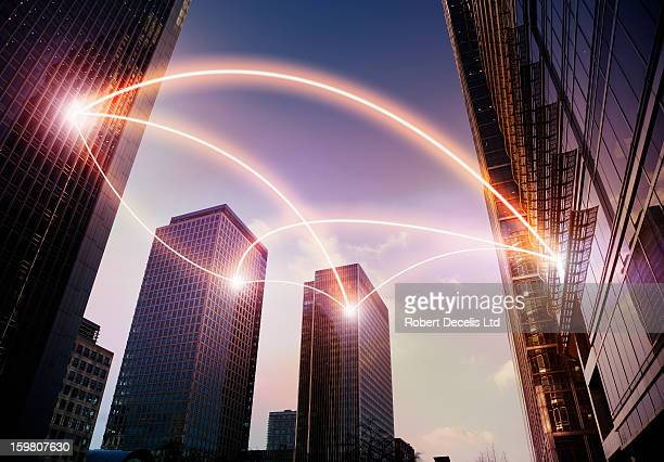 Office buildings connected by light trails.