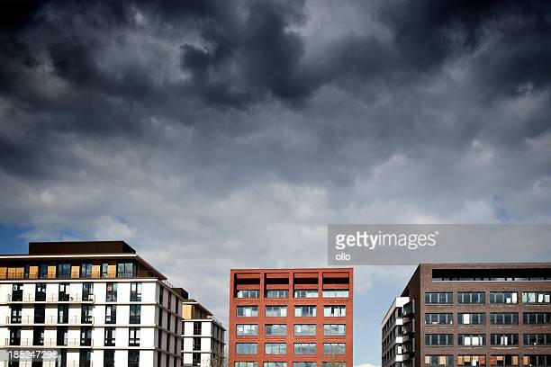 Office buildings facades, dramatic sky