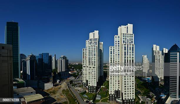office buildings in business district - emreturanphoto stock pictures, royalty-free photos & images