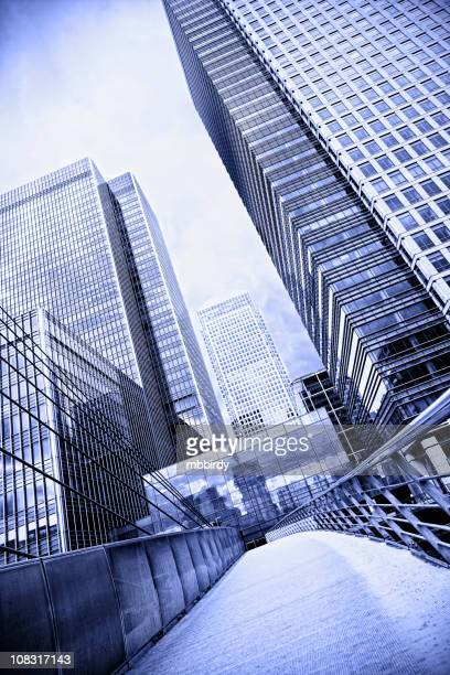 office buildings in canary wharf, london - canary wharf stock photos and pictures