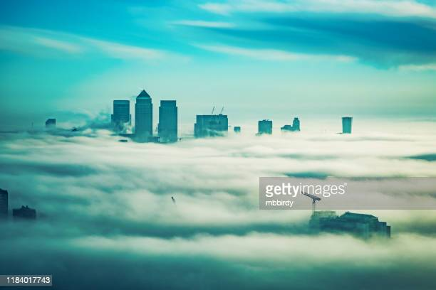 office buildings in canary wharf, london - tower stock pictures, royalty-free photos & images