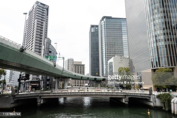 office buildings in nakanoshima in osaka in japan - taro hama ストックフォトと画像