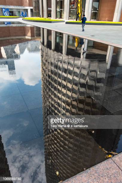 Office buildings reflected on pool in Singapore