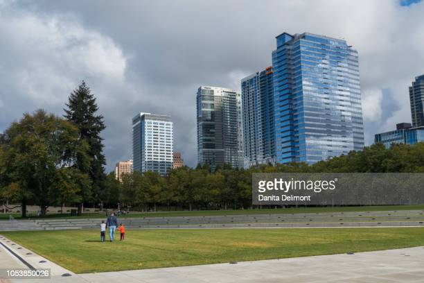 office buildings seen from downtown park, bellevue, king county, washington state, usa - bellevue washington state stock photos and pictures