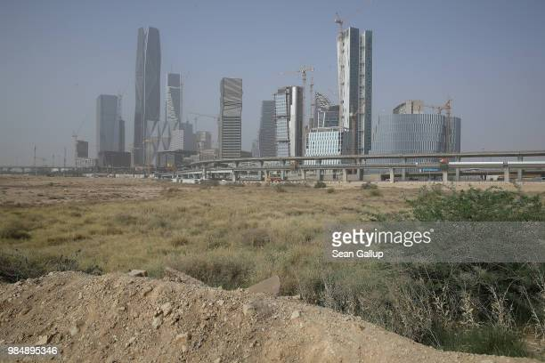 Office buildings stand at the construction site of the new King Abdullah Financial District on June 20 2018 in Riyadh Saudi Arabia The development is...