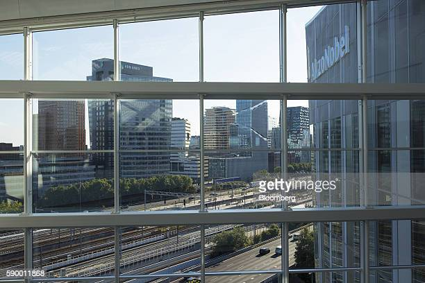 Office buildings stand beyond a road highway and railway lines seen from the headquarters of Akzo Nobel NV in the Zuidas business district of...