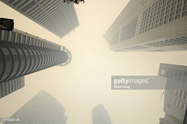 Office buildings stand shrouded in smog in Singapore, on Friday, June 21, 2013. Singapore's smog hit its worst level, blanketing the city-state in...