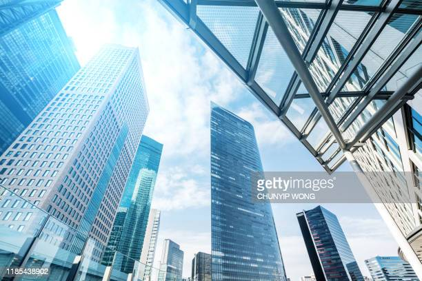office buildings with sunlight - business community stock pictures, royalty-free photos & images