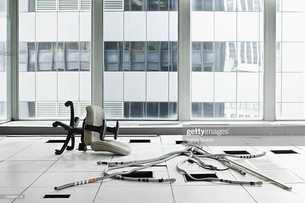 Office chair and cables on floor : Stock Photo