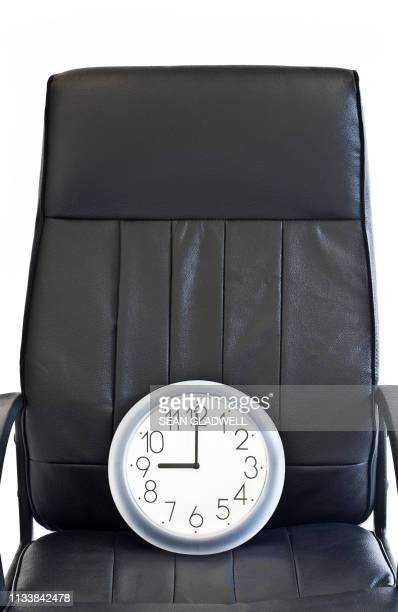 office chair at 9 o'clock - clocks go forward stock pictures, royalty-free photos & images