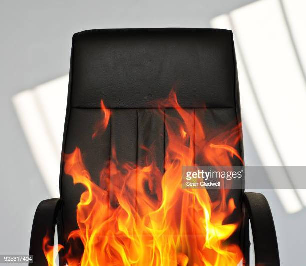 office chair on fire - burning stock pictures, royalty-free photos & images