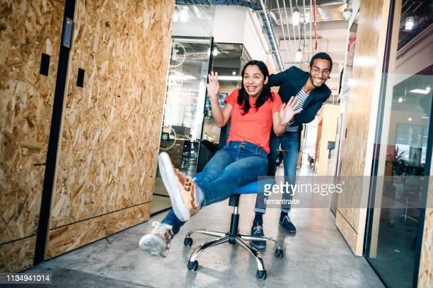 office chair race - naughty america foto e immagini stock